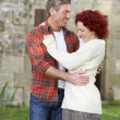 Couple in country garden - Stock Photo