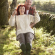 Couple with country garden swing — Stock Photo