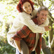 Couple picking apples off tree — Stock Photo #11885115