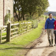 Couple on country walk — Stok Fotoğraf #11885138