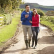 Couple on country walk — Stock Photo