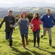 Couples on country walk - Stock Photo