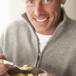 Man eating bowl of soup — Stock Photo