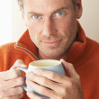 Man with hot drink — Stock Photo