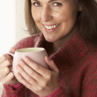 Woman with hot drink — Stock Photo #11885183