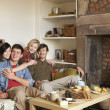 Foto Stock: Young couples in cosy cottage