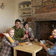 Young couples in cosy cottage — Stok fotoğraf