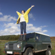 Young woman in countryside with SUV — Stock Photo