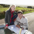 Young couple on country drive - Stock Photo