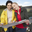 Young women on country drive — Stock Photo