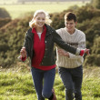 Young couple on country walk - Stock Photo