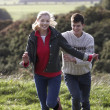 Young couple on country walk — Foto Stock