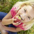 Portrait of happy girl with apple — Stock Photo #11885668