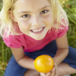 Portrait of happy girl with orange — Stock Photo #11885674