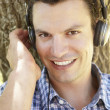 Stock Photo: Young man listening music