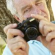 Senior man with camera — Stock Photo