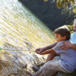 Man and boy fishing together - Stock Photo