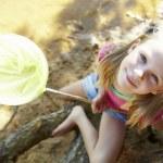 Happy girl fishing at lake — Stock Photo