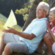 Senior couple fishing together — Stockfoto
