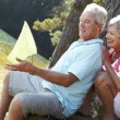Stock Photo: Senior couple fishing together