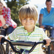 Young family on country bike ride — Stock Photo #11885880
