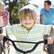 Stock Photo: Young family on country bike ride