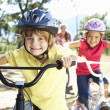 Young family on country bike ride — Stock Photo #11885898