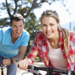 Young couple on country bike ride — Stock Photo