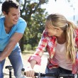Royalty-Free Stock Photo: Young couple on country bike ride