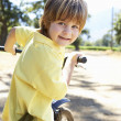 Little boy on country bike ride - Stock Photo