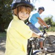 Little boy on country bike ride with dad — Stock Photo #11885908