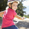 Little girl on country bike ride — Stock Photo #11885916
