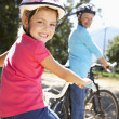 Little girl on country bike ride with grandma — Stock Photo #11885917