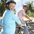 Royalty-Free Stock Photo: Senior couple on country bike ride