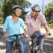 Senior couple on country bike ride — Stock Photo