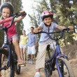 Family on country walk with bikes — Stock Photo