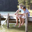 Senior man fishing with grandson — Stock Photo #11886050