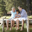 Father,son and grandson fishing together — Stock Photo #11886061