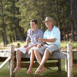 Father and adult son fishing together — Stock Photo