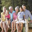 3 Generation family sitting by lake — Stock Photo