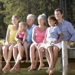 3 Generation family sitting by lake — Stock Photo #11886085