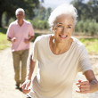 Senior couple on country run — Stock Photo