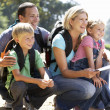 Young family on country walk — Stock Photo #11886183