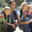 Young family on country walk — Stock Photo