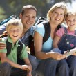 Young family on country walk — Stock Photo #11886187