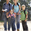 Stock Photo: Young family on country walk