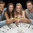 Two young couples in restaurant — Stock Photo #11886212