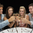 Two young couples in restaurant — Stock Photo