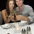 Stock Photo: Young couple in restaurant