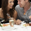 Young couple in restaurant — Stock Photo